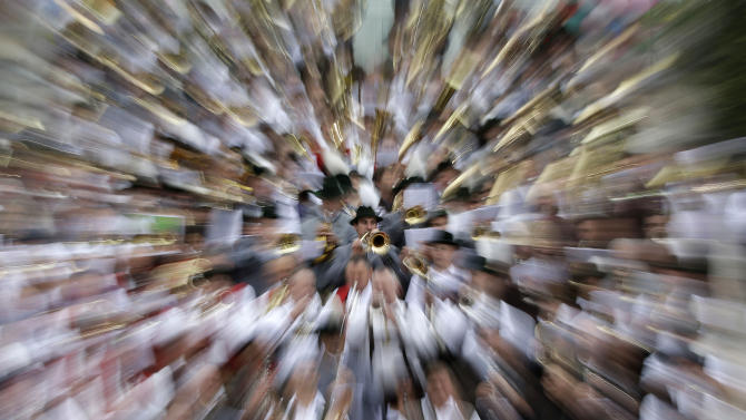The zoomed picture shows musicians of the Oktoberfest orchestra playing at the famous Oktoberfest beer festival in Munich, southern Germany, Sunday, Sept. 30, 2012. The world's largest beer festival, to be held from Sept. 22 to Oct. 7, 2012 will see some million visitors. (AP Photo/Matthias Schrader)