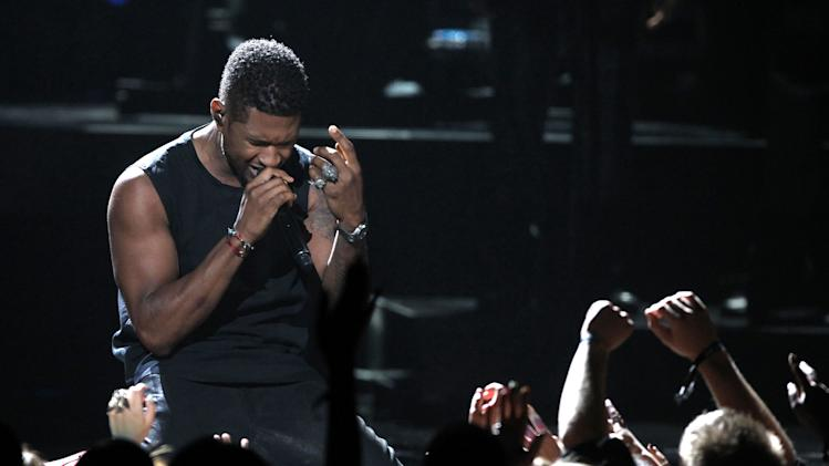 Usher performs at the BET Awards on Sunday, July 1, 2012, in Los Angeles. (Photo by Matt Sayles/Invision/AP)