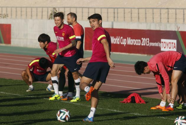 Zheng of China's Guangzhou Evergrande controls the ball during a training session in Agadir Stadium