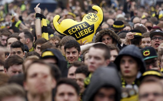 Borussia Dortmund fans cheer before a public viewing in downtown Dortmund of the Champions League soccer final between Bayern Munich and Borussia Dortmund at Wembley in London