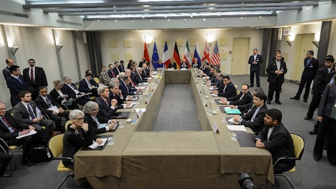 P5+1 European Union officials and Iranian officials wait for the start of a meeting on Iran's nuclear program at the Beau Rivage Palace Hotel March 30, 2015 in Lausanne