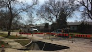 A large sinkhole in Winnipeg's north end has been taped off by police.
