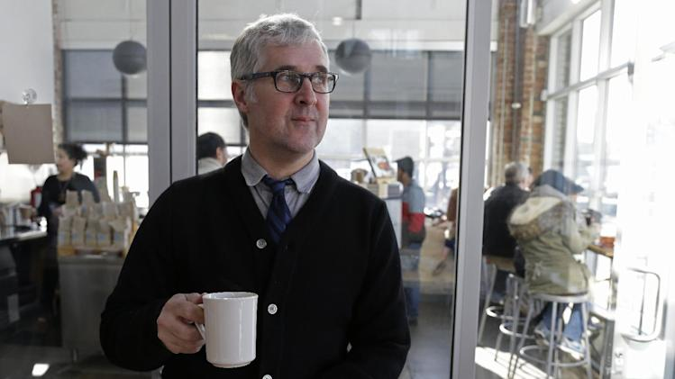 n this photo taken Thursday, Jan. 3, 2013, James Freeman, founder of Blue Bottle Coffee poses after cupping samples of coffee at his roastery in Oakland, Calif. (AP Photo/Eric Risberg)