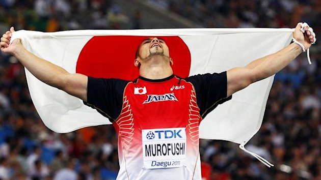 Koji Murofushi of Japan celebrates winning the men's hammer throw final at the IAAF World Championships in Daegu August 29, 2011.