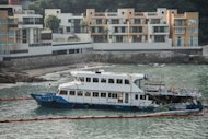 The Lamma IV passenger boat, with the back end of the vessel badly damaged after a collision, lies near the shores of Hong Kong's Lamma island on October 3, 2012