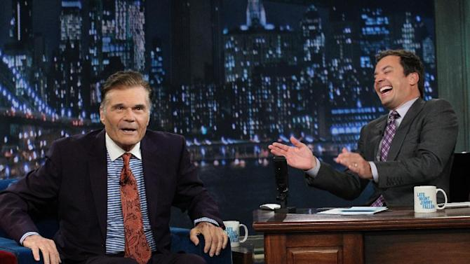 """In this photo taken Thursday, July 26, 2012 and provided by NBCUniversal, actor Fred Willard, left, joins host Jimmy Fallon on the set of Fallon's NBC show """"Late Night,"""" in New York. (AP Photo/NBCUniversal, Lloyd Bishop)"""
