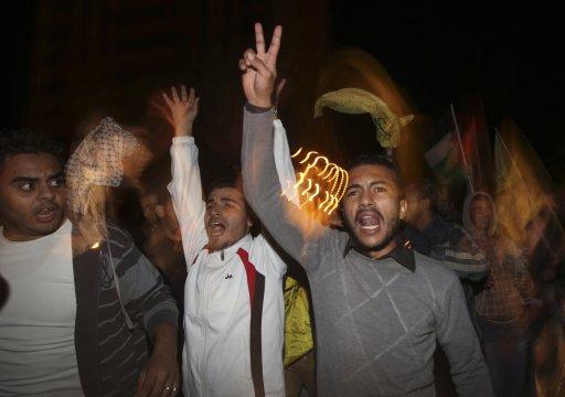 Palestinians celebrate on a street in Gaza City