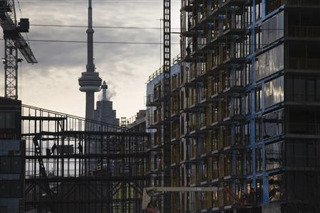 Construction workers work on a condominium development in Toronto December 6, 2012. REUTERS/Mark Blinch