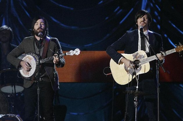 "FILE - This Nov. 29, 2011 file photo shows Scott Avett, left, and Seth Avett of The Avett Brothers performing at the CMT Artists of the Year television taping in Nashville, Tenn. Their latest album ""The Carpenter,"" was released this month. (AP Photo/Mark Humphrey, file)"