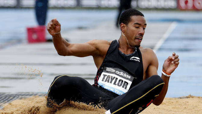 Christian Taylor, of the USA, competes in the Men's Triple Jump during the IAAF Diamond League Grand Prix competition on Randall's Island  Saturday, May 25, 2013, in New York. (AP Photo/John Minchillo)