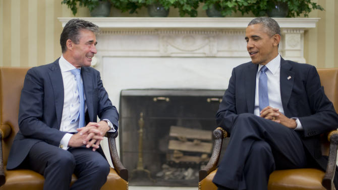 President Barack Obama meets with NATO Secretary General Anders Fogh Rasmussen in the Oval Office of the White House in Washington, Tuesday, July 8, 2014. (AP Photo/Pablo Martinez Monsivais)