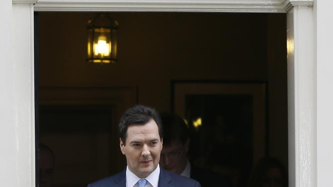 Britain's Chancellor George Osborne leaves 11 Downing Street to deliver his annual budget speech to the House of Commons in London, Wednesday, March 20, 2013. (AP Photo/Kirsty Wigglesworth)