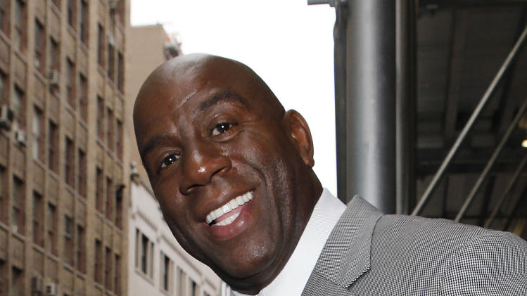 "IMAGE DISTRIBUTED FOR ORAQUICK - Earvin ""Magic"" Johnson stopped by the Wendy Williams Show to discuss the importance of HIV testing and to announce the nationwide availability of OraQuick® In-Home HIV Test, the first and only rapid over-the-counter (OTC) HIV test on Wednesday, Oct. 10, 2012 in New York. (Photo by Amy Sussman/Invision for OraQuick/AP Images)"