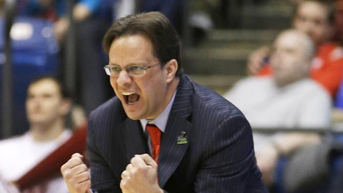 Indiana coach Tom Crean urges on his players in the second half of a second-round game against James Madison at the NCAA men's college basketball tournament, Friday, March 22, 2013, in Dayton, Ohio. (AP Photo/Al Behrman)