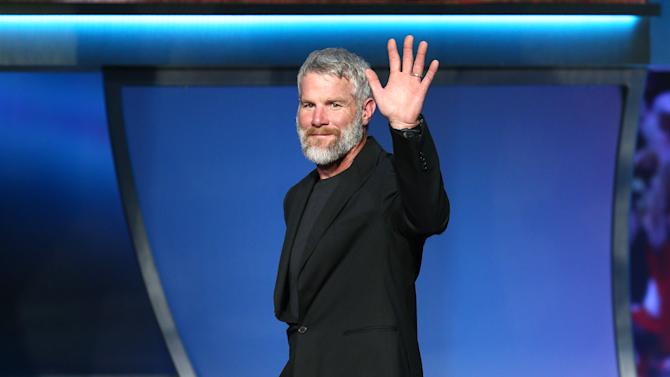 Former NFL quarterback Brett Favre waves after being elected to the Pro Football Hall of Fame, at the fifth annual NFL Honors at the Bill Graham Civic Auditorium on Saturday, Feb. 6, 2016, in San Francisco. (Photo by John Salangsang/Invision for NFL/AP Images)