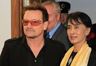 Myanmar democracy icon Aung San Suu Kyi (R) and Irish singer Bono (L) arrive at Dublin airport in Dublin, Ireland. Aung San Suu Kyi landed in Ireland on Monday for a flying visit on her European tour, with U2 star Bono by her side as she headed to collect a prize honouring her unwavering commitment to human rights
