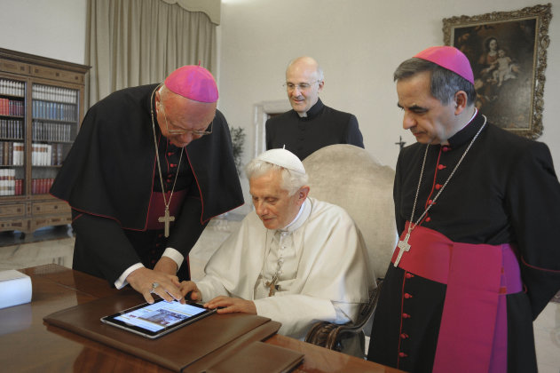 FILE - In this June 28, 2011 file photo, Pope Benedict XVI touches a touchpad to send a tweet for the launch of the Vatican news information portal &quot;www.news.va&quot;, at the Vatican. The Vatican said Monday, Dec. 3, 2012, that Pope Benedict XVI will start tweeting in six languages from his own personal handle (at)Pontifex, on Dec. 12. The pontiff will be using a question and answer format in his first Tweet, focusing on answering questions about faith  in 140 characters. (AP Photo/Osservatore Romano, File) EDITORIAL USE ONLY