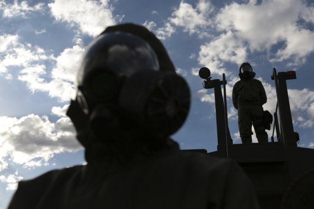 Brazilian army soldiers wearing chemical suits participate in an anti-terror simulation exercise as part of the preparation for the upcoming 2013 FIFA Confederations Cup in Brasilia