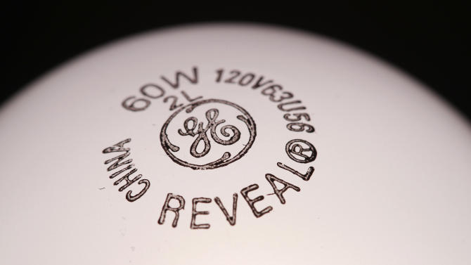 This Jan. 17, 2012 photo, shows a General Electric brand light bulb in Surfside, Fla. General Electric said Friday, Jan. 20, 2012, its fourth-quarter earnings fell 18 percent on lower sales and a provision for income taxes. (AP Photo/Wilfredo Lee)