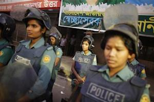 Police officers stand guard in front of the office of Bangladesh Nationalist Party during a strike in Dhaka