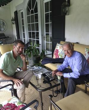 In this Aug. 18, 2013 image released by Beau Biden's Twitter account, @BeauBiden, Vice President Joe Biden sits with his son Beau Biden, in Delaware. A spokesman for the Department of Justice says Monday, Aug. 19, 2013, Delaware Attorney General Beau Biden has been hospitalized after becoming weak and disoriented after a drive for a family vacation. Spokesman Jason Miller said late Monday that Biden, the vice president's son, is currently undergoing testing in Houston to investigate the cause of his symptoms. (AP Photo/@BeauBiden)