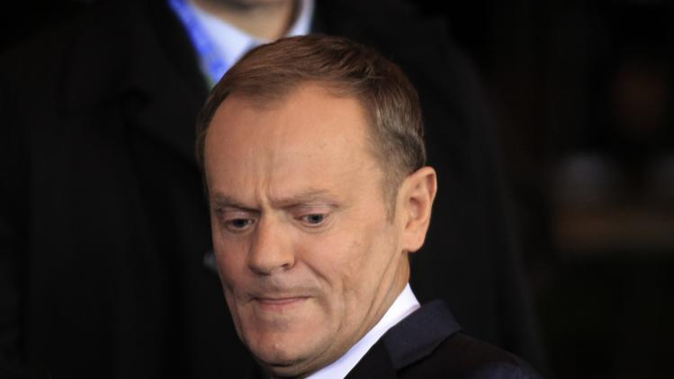 File photo shows Poland's PM Tusk leaving the EU council headquarters after a European Union leaders summit in Brussels