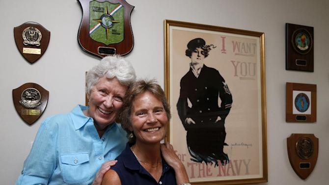 Joan Darrah, right, who served nearly 30 years in the Navy and lived through the Sept. 11 attack of the Pentagon, and her spouse, Lynne Kennedy, pose for a photo at their home in Alexandria, Va., Thursday, June 27, 2013. Just two years ago, gays were prevented from openly serving in the military. Now, with the Supreme Court ruling, same-sex spouses of gay veterans and service members will be able to share in their benefits. (AP Photo/Charles Dharapak)