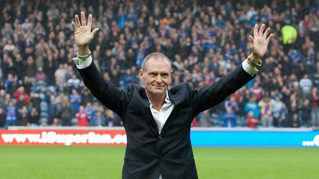 Former Rangers player Paul Gascoigne greets the supporters during the Clydesdale Bank Scottish Premier League match at Iborx Stadium, Glasgow.