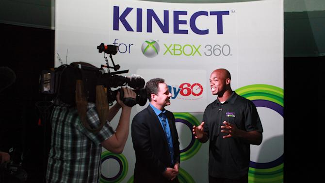 Fox News Brian Kilmende and NFL running back Adrian Peterson make an appearance playing Kinect for Xbox 360 with kids, on Thursday, Jan. 31, 2013 in New Orleans, LA. (Photo by Barry Brecheisen/Invision for Xbox/AP Images)