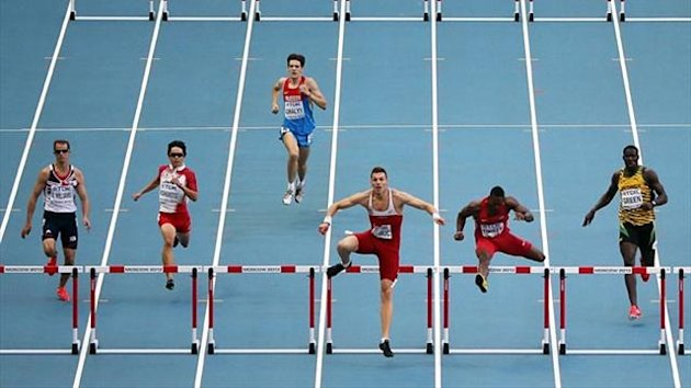 US's Michael Tinsley (2nd-R) and Serbia's Emir Bekric (3rd-R) lead heat 2 of the men's 400 metres hurdles semi-final at the 2013 IAAF World Championships at the Luzhniki stadium (AFP)