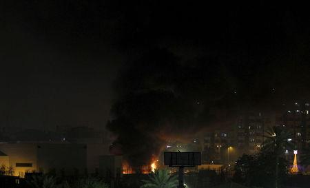 Smoke rises from the site of car bomb attack in Baghdad