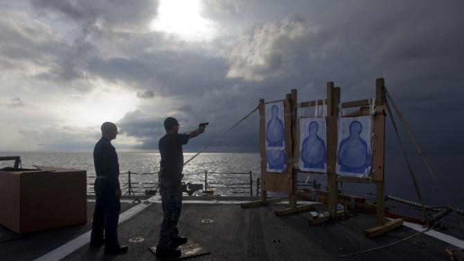 ADVANCED FOR USE SUNDAY FEB. 3 AND THEREAFTER In this Wednesday, Oct. 10, 2012 photo, a U.S. Navy sailor participates in small arms target practice at the USS Underwood while patrolling in international waters near Panama. In the most expensive initiative in Latin America since the Cold War, the U.S. has militarized the battle against drug traffickers, spending more than $20 billion in the past decade.  U.S. Army troops, Air Force pilots and Navy ships outfitted with Coast Guard counternarcotics teams are routinely deployed to chase, track and capture drug smugglers. (AP Photo/Dario Lopez-Mills)