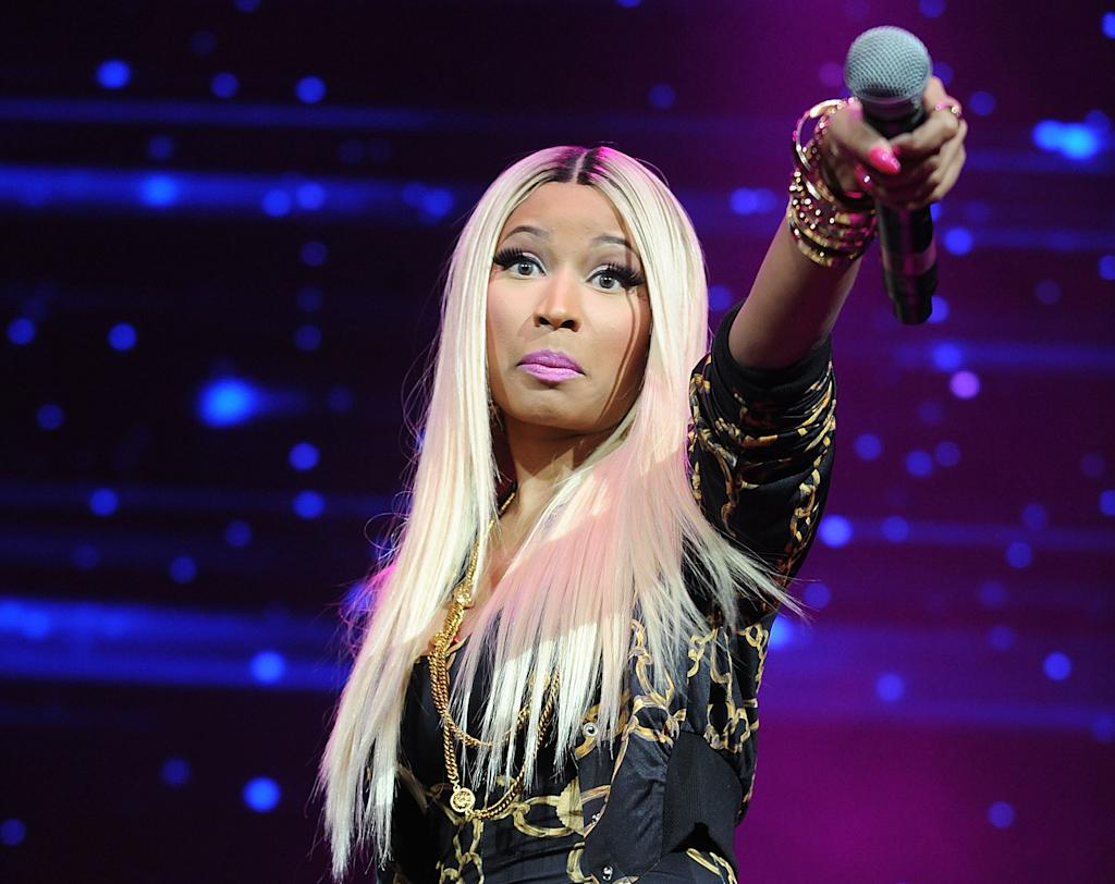 "FILE - This Nov. 2, 2013 file photo shows hip-hop artist Nicki Minaj at the Power 105.1's Powerhouse Concert at the Barclays Center in New York. Minaj is being criticized after using a photo of Malcolm X with a gun in his hands, juxtaposed with a racial slur, for her new single. Minaj posted the photo Wednesday, Feb. 12, 2014, on her website and Instagram page. Malcolm X's family and estate said her use of the black nationalist for her single artwork is disrespectful and offensive. In an exclusive statement to The Associated Press on Friday, Feb. 14, Malcolm X's daughter, Ilyasah Shabazz, said Minaj's use of the picture is ""in no way is endorsed by my family."" (Photo by Brad Barket/Invision/AP, File)"