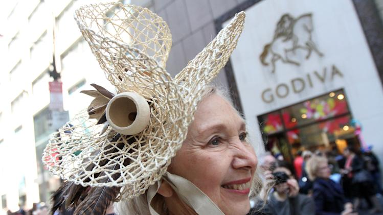 Dressed for the occasion, Pauline Watona poses for photograph as she takes part in the Easter Parade along New York's Fifth Avenue, Sunday, April 20, 2014. (AP Photo/Tina Fineberg)