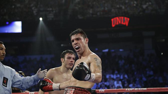 Sergio Martinez, right, reacts as the bell rings to end the 10th round against Julio Cesar Chavez Jr. during the WBC middleweight title fight, Saturday, Sept. 15, 2012, in Las Vegas. Martinez won by unanimous decision. (AP Photo/Julie Jacobson)