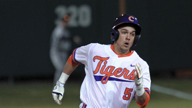 Clemson's Chase Pinder rounds second on his way to third with a three-run  triple in an NCAA college baseball game against South Carolina in Clemson, S.C., on Friday, Feb. 27, 2015. (AP Photo/Anderson Independent-Mail, Mark Crammer)