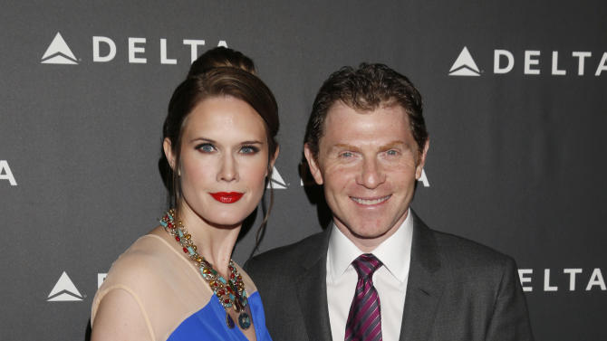 Stephanie March and Bobby Flay attend a Celebration of LA's Music Industry at the Getty House on Thursday, Feb. 7, 2013 in Los Angeles. (Photo by Todd Williamson/Invision/AP)