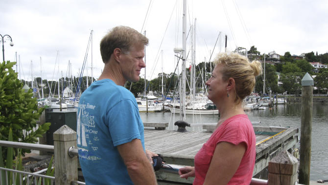In this undated photo provided by Robin Wright, Ricky Wright and wife Robin Wright, from Lafayette, Louisiana, stand at a dock in the New Zealand port of Whangarei, where the wooden sailboat Nina was moored in 2013. The couple have continued to search for their daughter Danielle, who was aboard the schooner and went missing at sea in the South Pacific more thaneight months ago. (AP Photo/Courtesy of Robin Wright) EDITORIAL USE ONLY