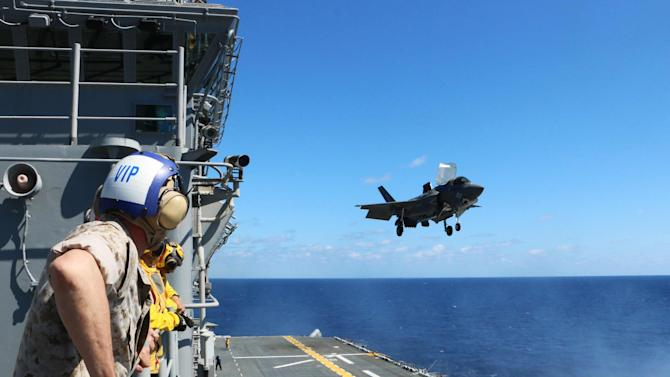 Lieutenant General Jon Davis watches an F-35B land aboard the USS Wasp during testing off the coast of North Carolina