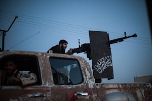 A member of an Islamist Syrian opposition group fires…