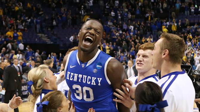 Kentucky forward Julius Randle celebrates with cheerleaders after a Third Round NCAA Tournament game between Wichita State and Kentucky on Sunday, March 23, 2014, at the Scottrade Center in St. Louis