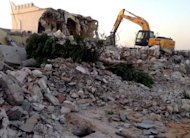 Libyan Islamist hardliners use a bulldozer to raze the mausoleum of Al-Shaab Al-Dahman near the centre of Tripoli. Islamist hardliners bulldozed part of the revered mausoleum in Tripoli in the second such attack in Libya in two days, an AFP correspondent reported