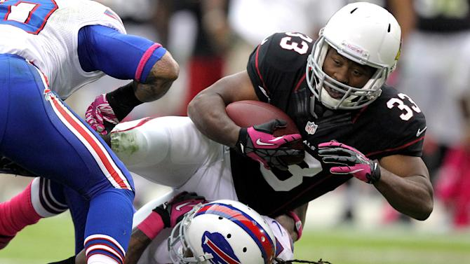 Arizona Cardinals running back William Powell (33) is stopped by Buffalo Bills cornerback Stephon Gilmore (27) during the first half of an NFL football game on Sunday, Oct. 14, 2012, in Glendale, Ariz. (AP Photo/Paul Connors)