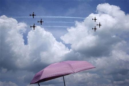 Pilatus PC-9 aircraft of the RAAF Roulettes aerobatic display team perform during the Singapore Airshow