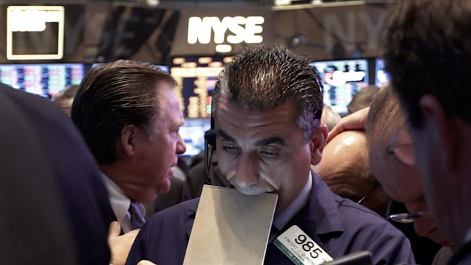 In this Thursday, May 23, 2013, photo, Trader Vincent Quinones, center, works on the floor of the New York Stock Exchange at the close of trading. Steady growth in hiring in May 2013 is sending the stock market sharply higher, Friday, June 7, 2013. (AP Photo/Richard Drew)