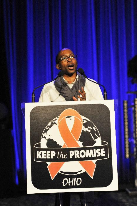 "Youth advocate Adrian Neal Jr. addresses the crowd at the AIDS Healthcare Foundation's ""Keep The Promise On AIDS"" March and Rally, on Saturday, May 11, 2013 in Cleveland, Ohio. (David Richard /AP Images for AIDS Healthcare Foundation)"