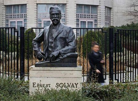 The statue of Ernest Solvay is seen outside the company's headquarters in Brussels