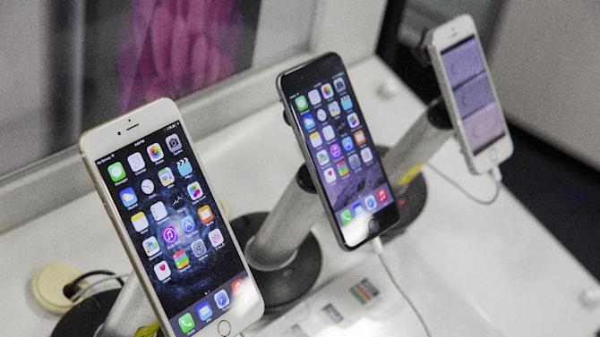 Apple's booming iPhone sales saw the US firm's quarterly profit rocket to a record $18 billion at the end of 2014