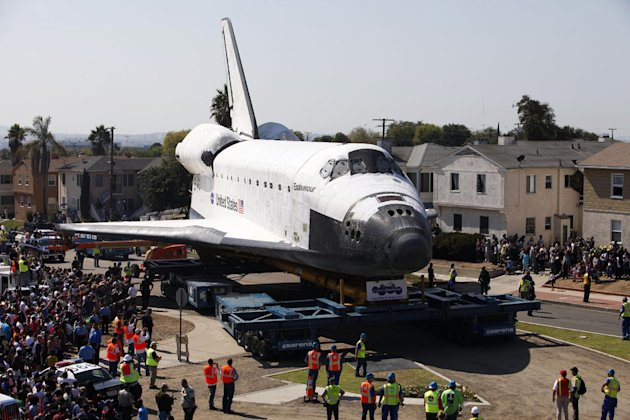 After more than 130 missions, the four remaining space shuttles of NASA&#39;s fleet found their way to their final resting places after being flown, placed on transport vehicles, and then hauled through streets to museums and science centers. (Patrick T. Fallon/AP Photo)