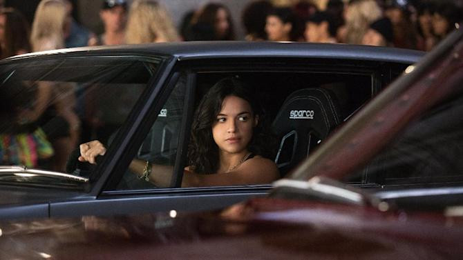 """This film publicity image released by Universal Pictures shows Michelle Rodriguez in a scene from """"Fast & Furious 6."""" (AP Photo/Universal Pictures, Giles Keyte)"""